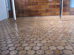 love this cork floor sort of industrial end grain wood floors