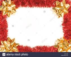 red tinsel and gold bows as a christmas background to frame your