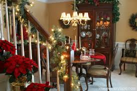 21 rosemary lane my sister s romantic christmas dining room so we thought it would be romantic to fill the dining room with beautiful christmas candlelight plenty of greens and the sparkle of little twinkle lights