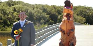 bride surprises husband by showing up to wedding in t rex costume