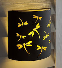 Metal Wall Sconces Battery Operated Metal Wall Sconce With Dragonfly Design Outdoor
