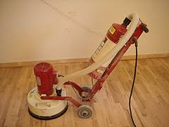 sanding a hardwood floor with a rental drum sander