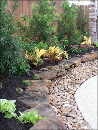 rustic flower beds with rocks in front of house ideas rustic