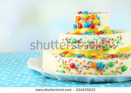 birthday cake colorful sprinkles candles stock photo