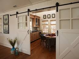 sliding barn doors offer both easy access to and privacy for this