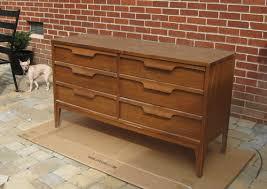 how to refinish veneer table nursery progress how to refinish a veneer dresser dresser wood