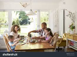 family home eating meal kitchen together stock photo 496630387
