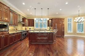 kitchen and eating area with island in luxury home stock photo