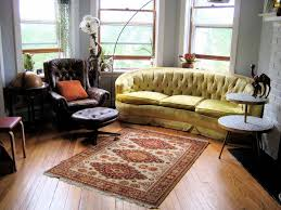 living room decoration with wood floor and persian rug u2014 jen