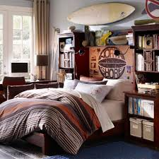 interior contemporary boy toddler bedroom with surfing board wall