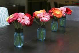 Mason Jar Flower Arrangement Daisies In Blue Mason Jars Something New For Dinner