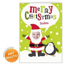 christmas face in the hole a festive card with their photograph