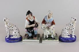 a pair of staffordshire ornaments cobbler and his 17cm high