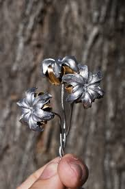 bullet flowers flowers made by shooting a 1911 gun don t ask me what of