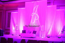 wedding backdrop monogram gorgeous headtable with pink uplighting crystals drapes and