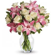 pink lillies white roses and bouquet white roses and pink lilies in a vase