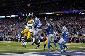 miracle aaron rodgers throws 61 yard hail to beat lions
