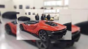 all black lamborghini first lamborghini centenario delivered in black and orange