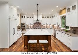 Hardwood Floors With White Cabinets Kitchen Interior Island Sink Cabinets Hardwood Stock Photo