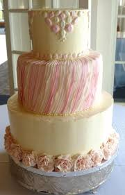 edible gems and ruffles on buttercream round wedding cake in ivory