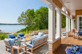 a cape cod shingle style home turns on the charm boston design guide new england waterfront views and landscape design