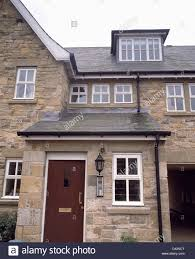 house with porch traditional stone house with porch extension and dormer window