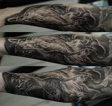 dragon forearm tattoos blue ink dragon tattoo on arm