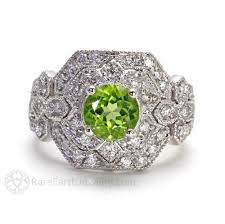 art deco style peridot and diamond ring with pave and milgrain