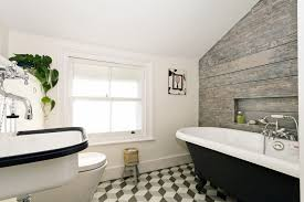 top floor bathroom 3d tiles wooden feature wall bucket sink top floor bathroom tiles wooden feature wall bucket sink from labour and wait and a lovely large painted roll top bath