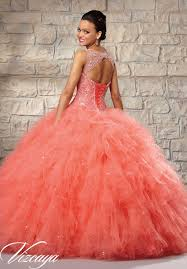coral pink quinceanera dresses embroidered and beaded bodice on a ruffled tulle skirt quinceanera