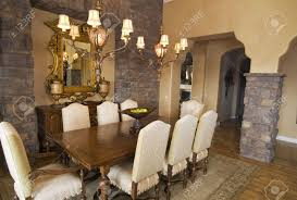 upscale formal dining room with wooden table stock photo picture