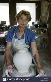 woman potter throwing a pot potters wheel craft pot pottery wheel