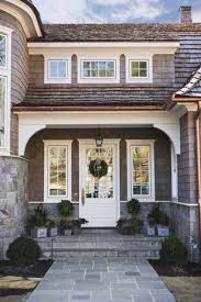 Modern Tudor Style Homes Architecture Unique Window Design With White Colored Wooden And