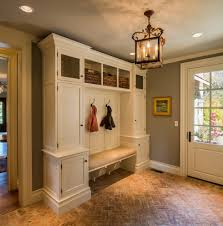 mud room bench entry traditional with black knobs brick floor