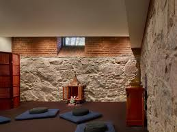 basement meditation room design with stone and brick wall tiles