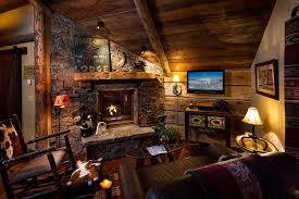 log cabin decor luxury cabin living area high ceilings stone