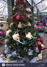 unusual christmas tree with colourful watering cans used as stock