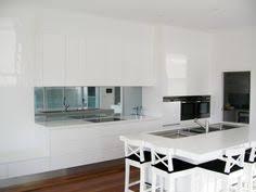 White On White Kitchen Ideas Mirror Splashback Kitchen With White Push Open Doors No Handles
