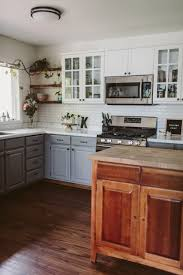 diy repaint kitchen cabinets transform your kitchen with diy painted cabinets liz morrow