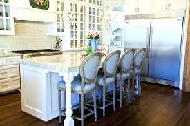 white counter stools with backswhite center island with light wood