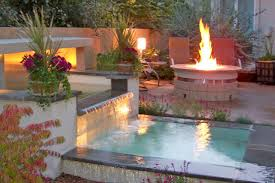 outdoor rooms with fire and water hgtv