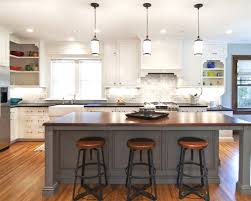 pendant lights bar with white kitchen cabinets bay window and