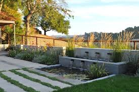 wood and metal fence ideas landscape contemporary with yellow