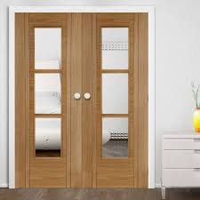 Glass Fire Doors by Capri Oak Flush Fire Door Pair With V Groove And Clear Glass Is