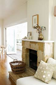 sandstone fireplace a warm casual feel is created by the addition of a roughly textured