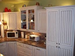 hand crafted white glazed beadboard kitchen by oak tree cabinetry