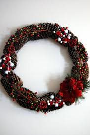 simple pinecone wreath with berries and flowers christmas wreath