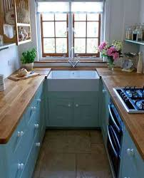blue kitcehn cabinet wooden countertop in small kitchen with