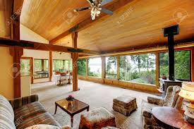 open floor plan in log cabin house view of living room and