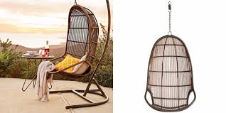 cozy black metal and rattan porch swing with stand and single